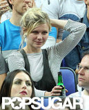 Kirsten Dunst wore her hair in a loose ponytail at the game.