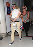 Gwen Stefani carried a sleepy-looking Zuma through LAX.