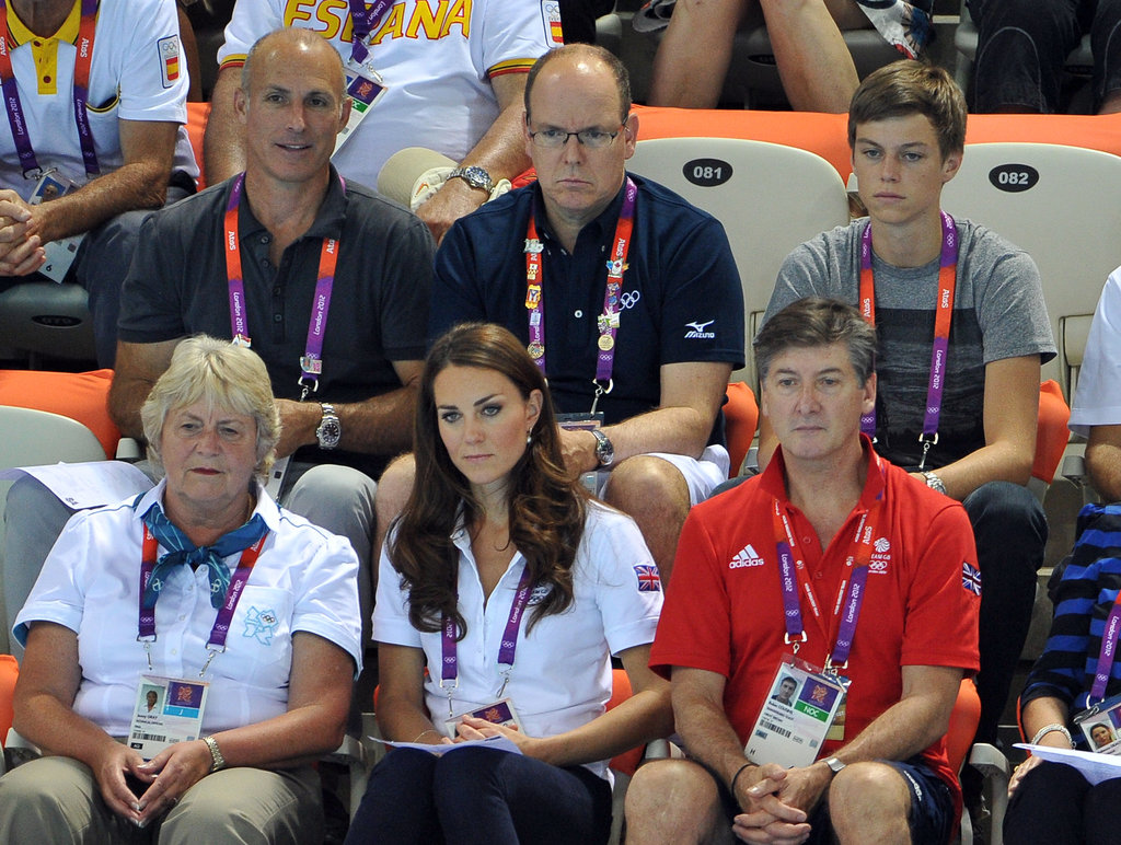 The Duchess of Cambridge, Prince Albert II, and GB ambassador Robin Cousins watched the women's teams synchronized swimming event at the 2012 London Olympic Games.