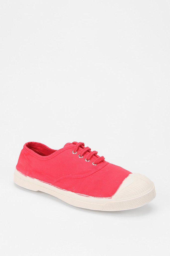 """You'll be on your feet most of the weekend so come prepared with a pair of comfortable sneakers. Bensimon is a no-fail option and who can say """"no"""" to a bold red kick? Bensimon Classic Tennis Sneaker ($55)"""