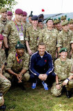 David Beckham posed with members of the security team for the Olympics.