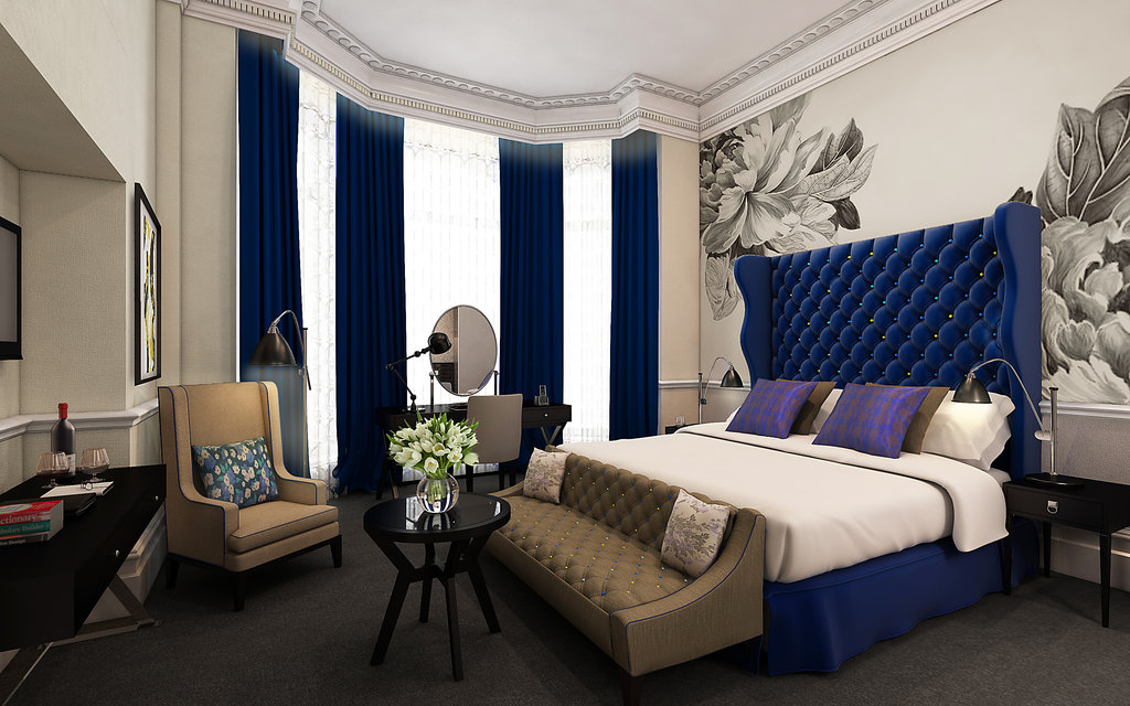 An oversize botanical design adds feminine splendor to this deluxe room at the Ampersand Hotel.
