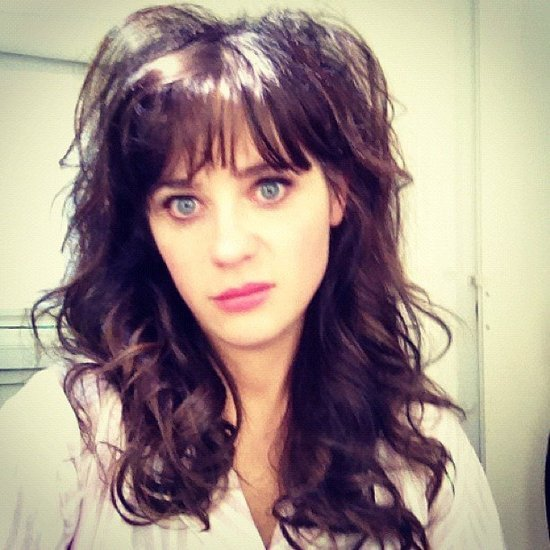 Zooey Deschanel showed off some seriously impressive bed hair.