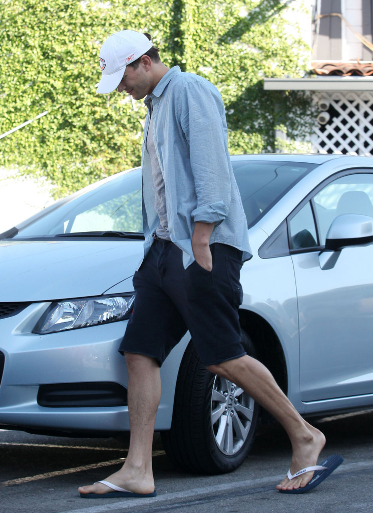 Ashton Kutcher wore a hat and shorts for a lunch date with Mila Kunis.