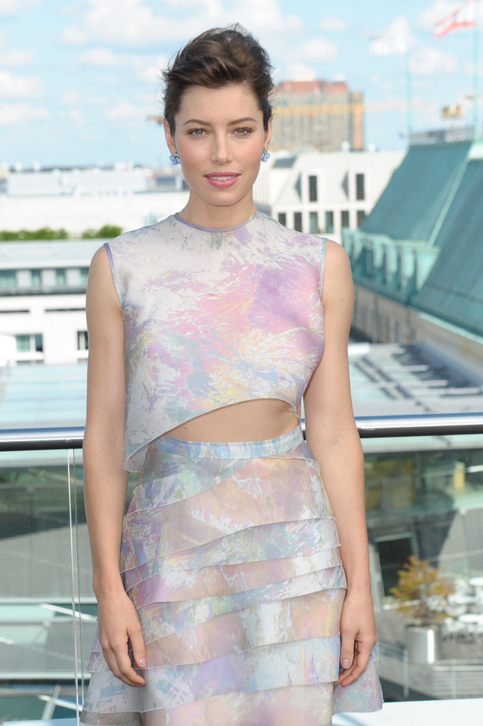 Jessica Biel showed off her midriff in a dress with cutouts at the Total Recall photocall in Berlin.