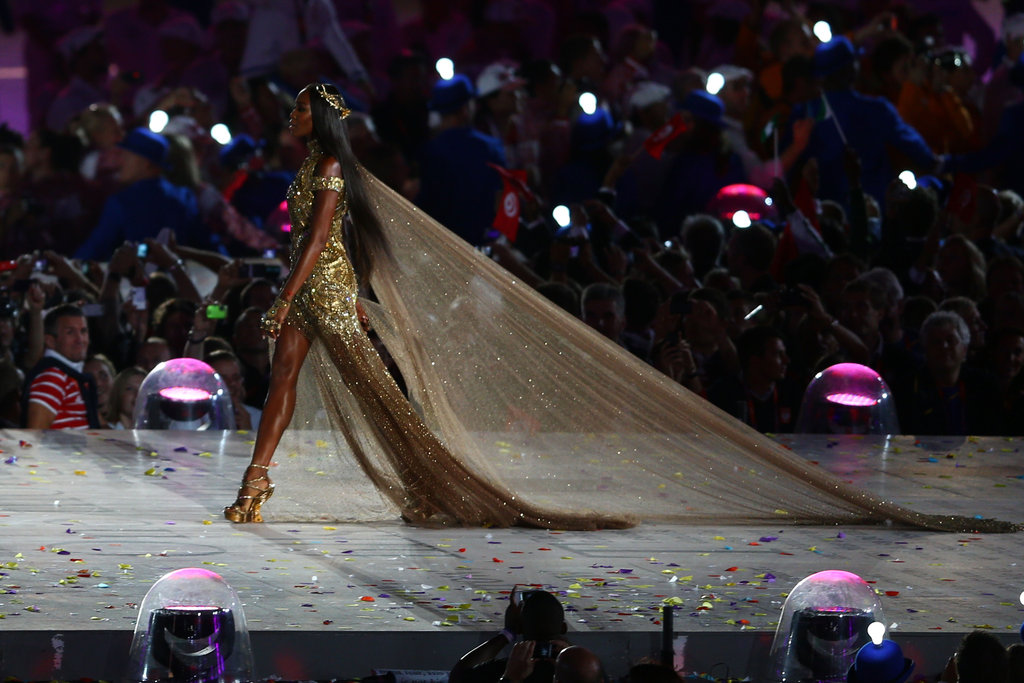 Talk about a dramatic train — Naomi left a striking golden trail via one long Alexander McQueen veil.