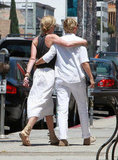 Portia de Rossi and Ellen DeGeneres had their arms around each other while walking around LA in August 2010.