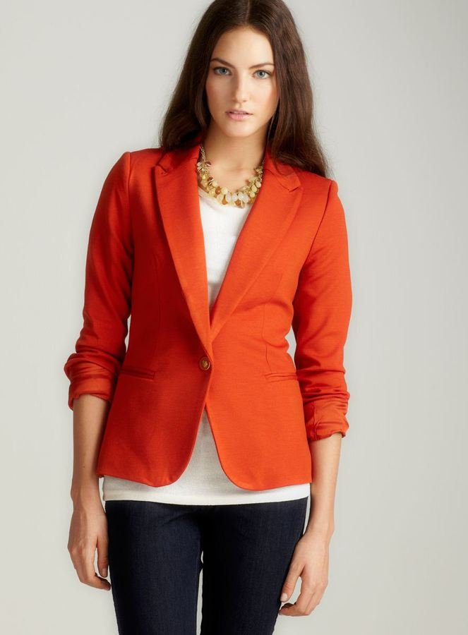 Perk up your day with this bright orange blazer. Vivienne Tam Long Sleeved Button Peak Lapel Blazer ($45, originally $98)