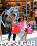 Katie Holmes and Suri Cruise walked through an NYC airport.