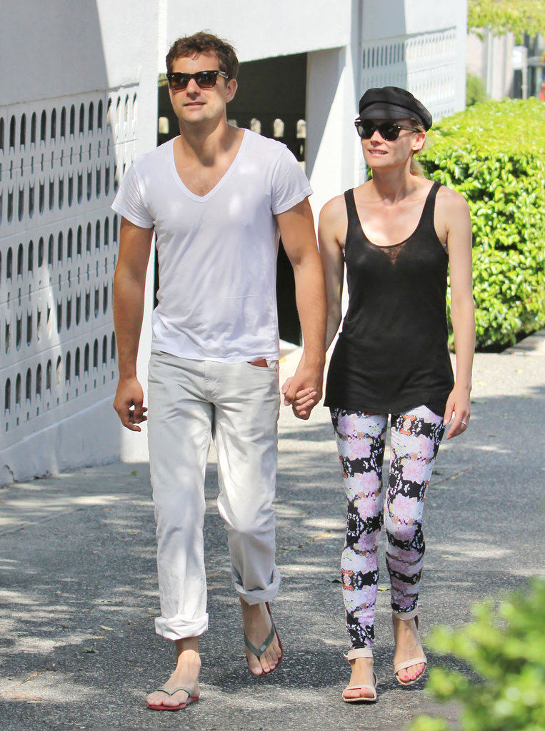 Diane Kruger donned a vibrant pair of printed Topshop leggings with her cool-girl newsboy cap and nude Givenchy flat sandals.