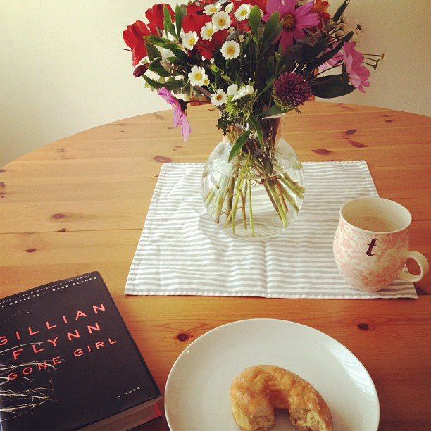 I started the day off right with a doughnut, a cup of coffee, and Gillian Flynn's Gone Girl.
