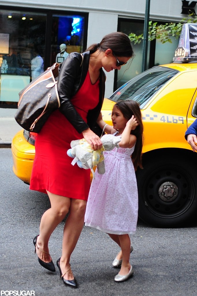 Katie Holmes and Suri Cruise got out of a taxi in NYC.
