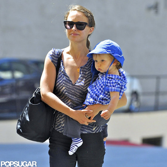 Natalie Portman carried Aleph Millepied on her hip.