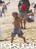 Kingston Rossdale ran around on the sand.