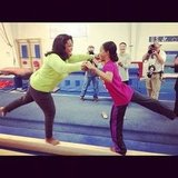Gold medalist Gabby Douglas taught Oprah Winfrey some tricks on the balance beam.  Source: Instagram user oprahwinfrey