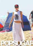 Gwen Stefani showed some skin under her cropped tank top on the beach.