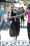 January Jones carried baby Xander while walking in LA.