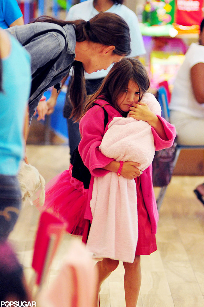 Suri Cruise and Katie Holmes went shopping in NYC.