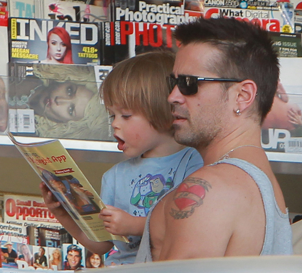 Henry Farrell scoped out a book while Colin Farrell held him.