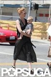 January Jones crossed the street with Xander.