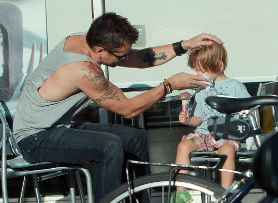 Colin Farrell helped clean up his son, Henry Farrell, after he ate an ice cream cone.