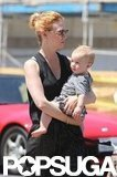 January Jones held tight to baby Xander.