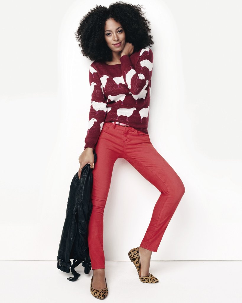 Solange gives us a lesson on bold color in a pair of red skinnies, a printed sweater, and leopard flats.
