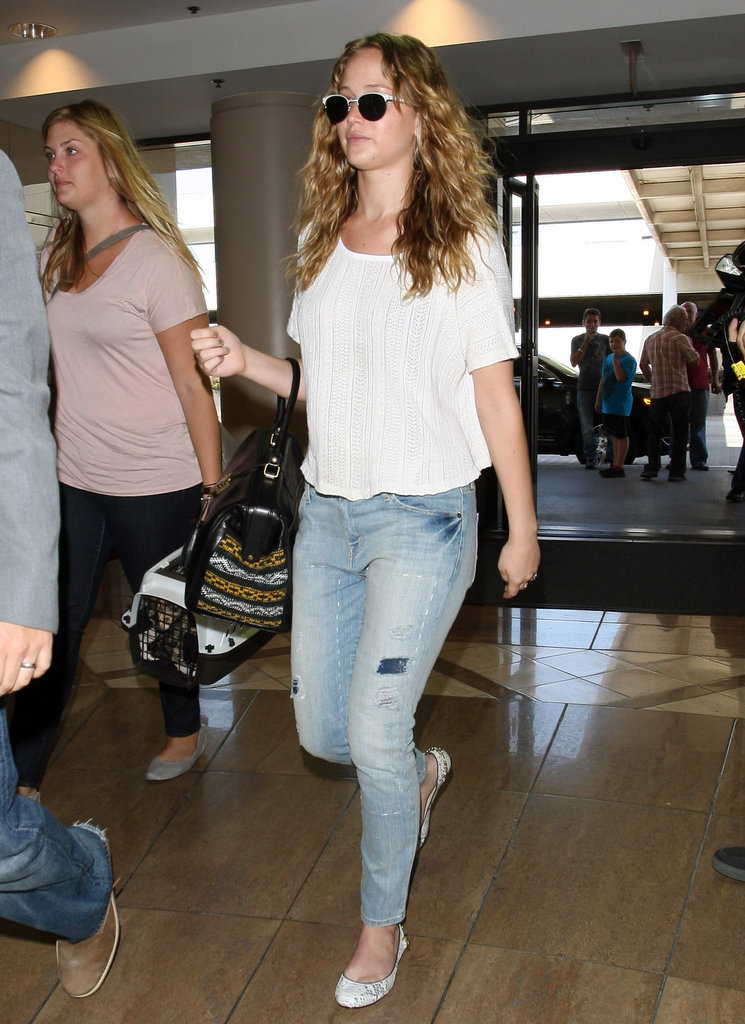 Jennifer Lawrence wore a white tee and ripped jeans.