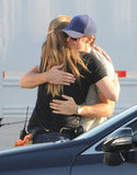 Ryan Gosling hugged a lady friend.