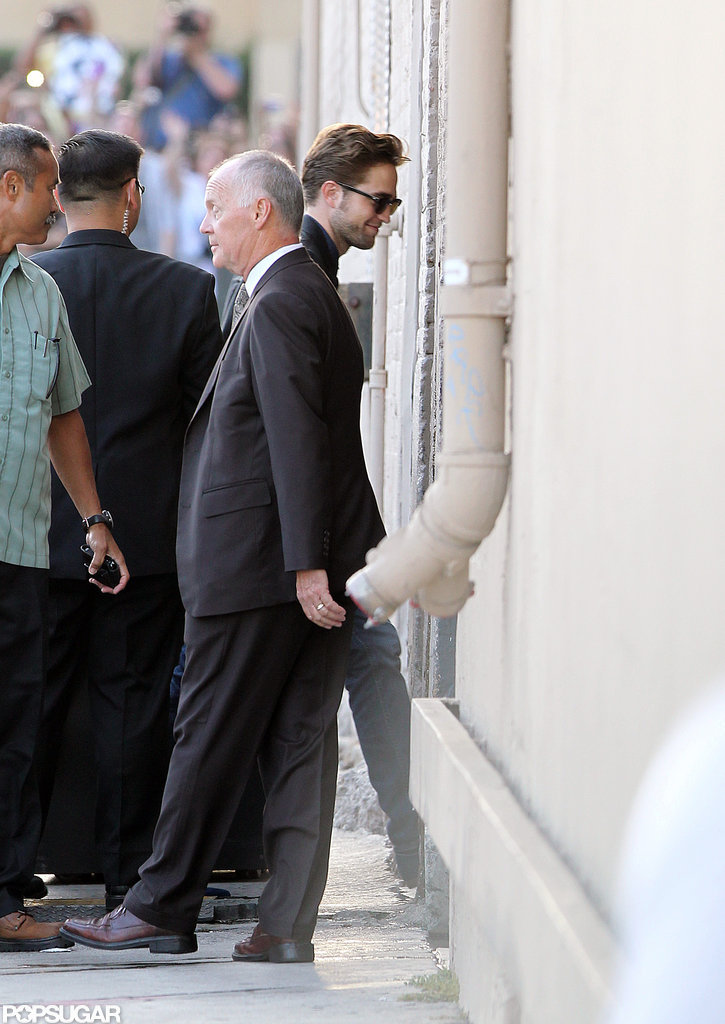 Robert Pattinson donned shades and a smile before his appearance on the Jimmy Kimmel Show.
