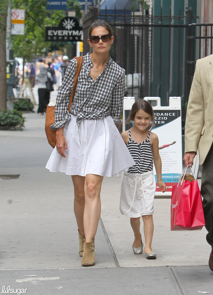Suri Cruise matched her mom, Katie Holmes, in a white skirt, striped tank, and metallic flats as they walked around NYC in June.