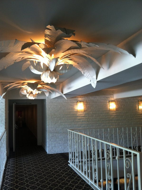 Here's a second look at the large palm-frond lights that illuminate the halls.