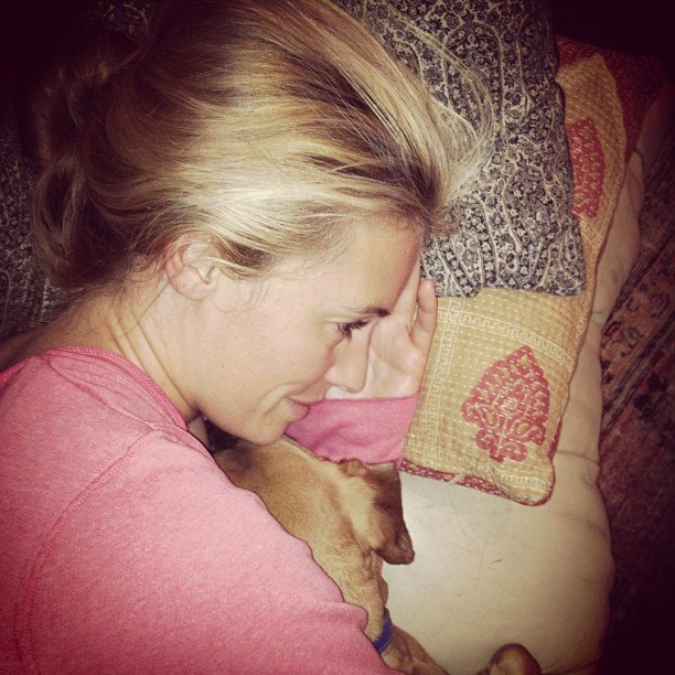 Cat Deeley cuddled in bed with her dog. Source: Instagram user catdeeley