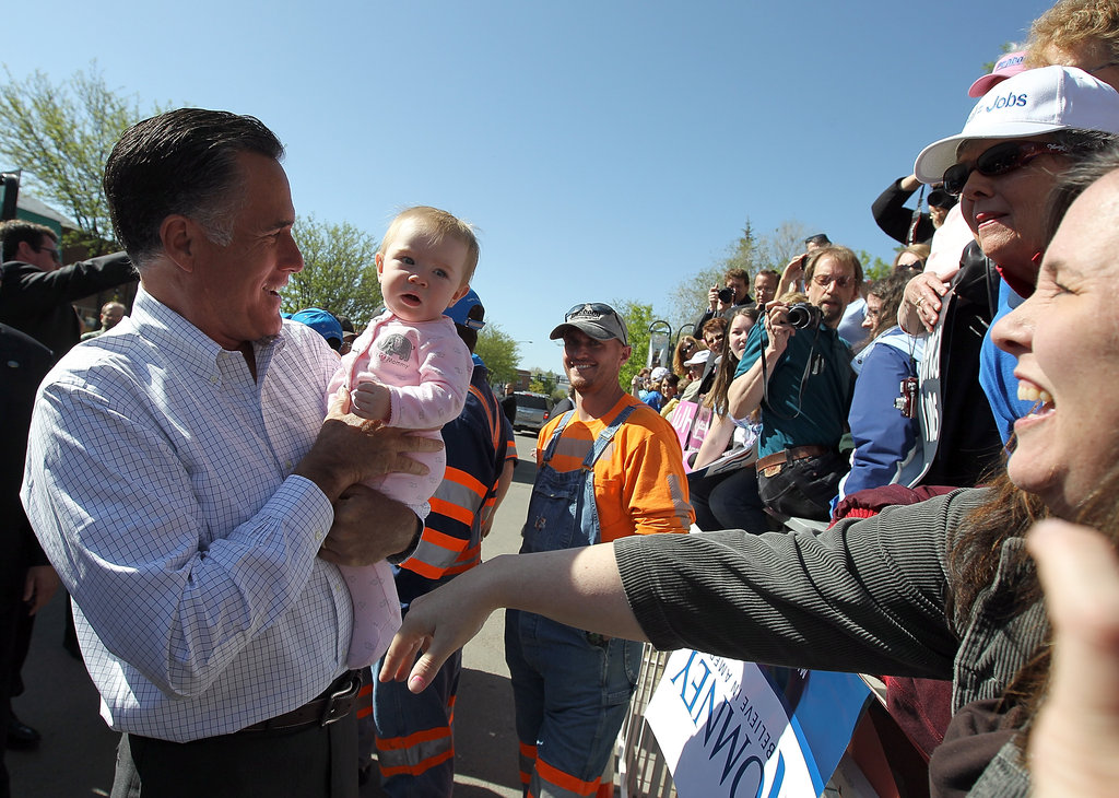 Presidential candidate Mitt Romney looked for support from a tiny event attendee during a stop in Craig, CO, back in May.