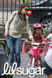 Katie Holmes showed Suri Cruise how to ride a bike in NYC.