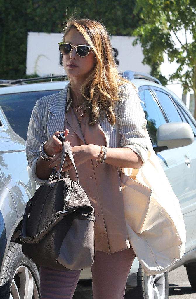 Jessica Alba carried a bag over one shoulder.