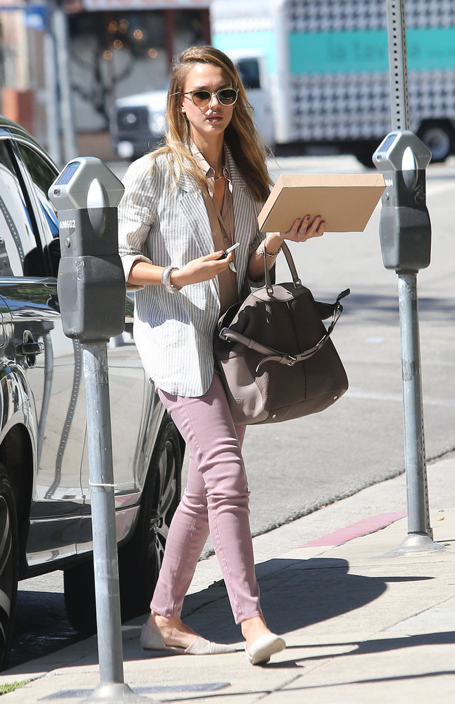Jessica Alba wore lavender jeans and flats.