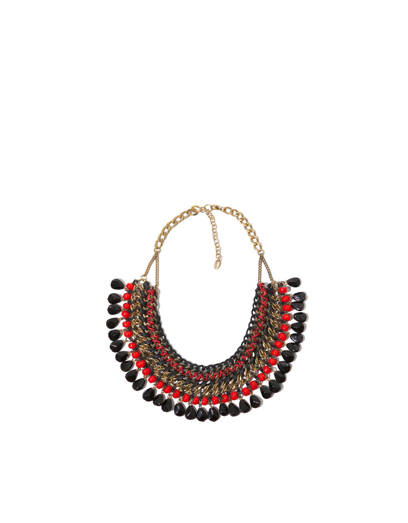 A pop of color and a hint of the tribal trend to dress up t-shirts, dresses, the list goes on and on.  Zara Necklace of Chains and Rope With Colored Stones ($30)