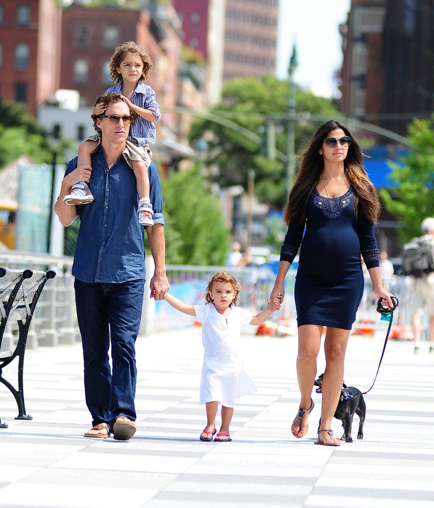 Camila Alves wore a formfitting dress and some casual sandals for a stroll through NYC with her family.