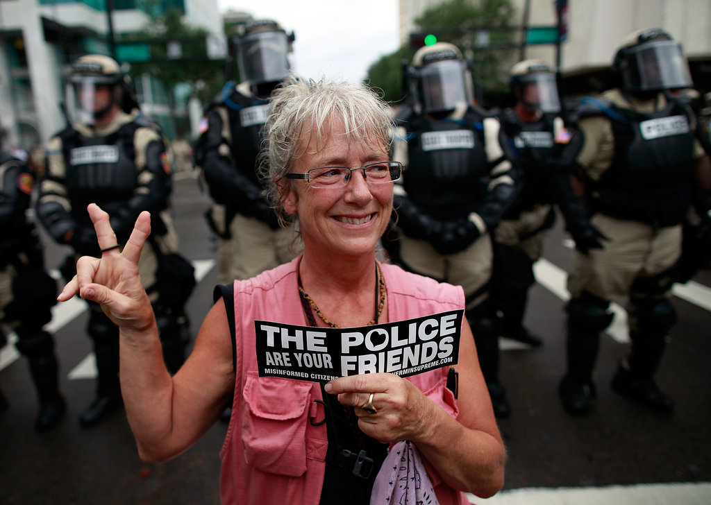 An activist stood in front of law enforcement in Tampa.