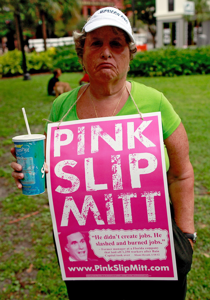 A female protestor wore a sign outside the convention.