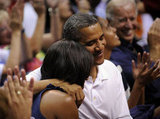 The Obamas embraced as they appeared on the Kiss Cam at an Olympic basketball game in Washington DC.