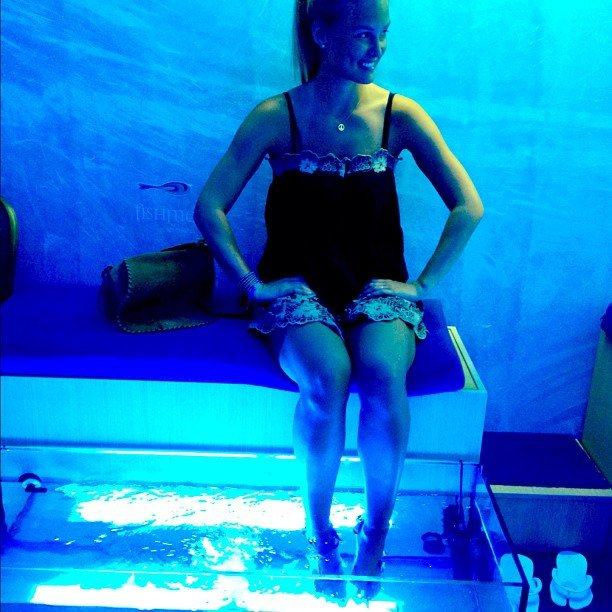 "Bar Refaeli shared a rather blue photo of herself in August with the caption, ""Who needs pedicures when there are little fish to eat your skin?! """