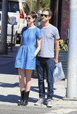 Anne Hathaway leaned back on Adam Shulman while taking a walk in LA.