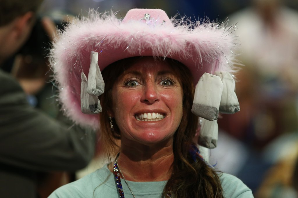 A woman wore a pink hat decorated with teabags inside the RNC.
