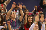 Kate Middleton put her hands in the air.
