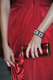 The actress paired a decadent green-jeweled cuff and a red clutch with her jawdropping red Alberta Ferretti gown.
