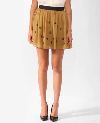 Wear this cute skirt to the office with a pretty blouse and black blazer. Forever 21 Embellished Short Skirt ($23)