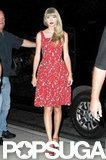 Taylor Swift wore a red patterned dress.