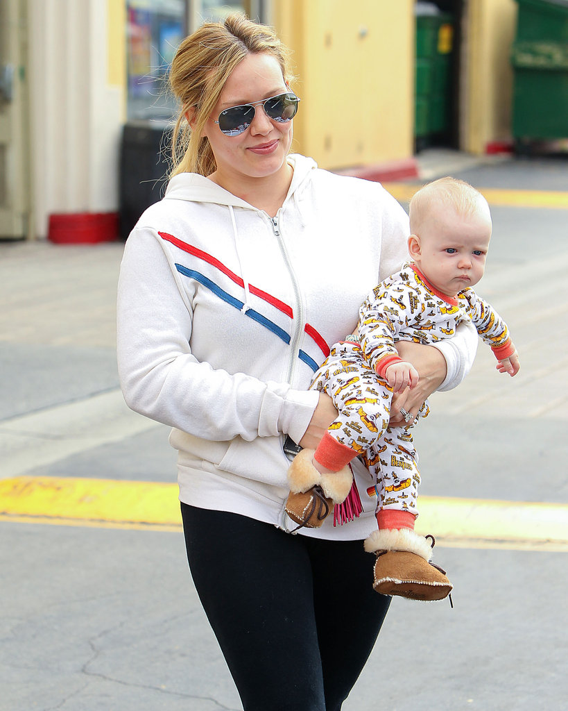 New mum Hilary Duff toted young son Luca around a farmer's market in Los Angeles on August 26.